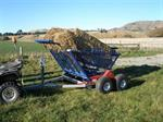 Self-Loading Tow Behind Round Bale-Feeders