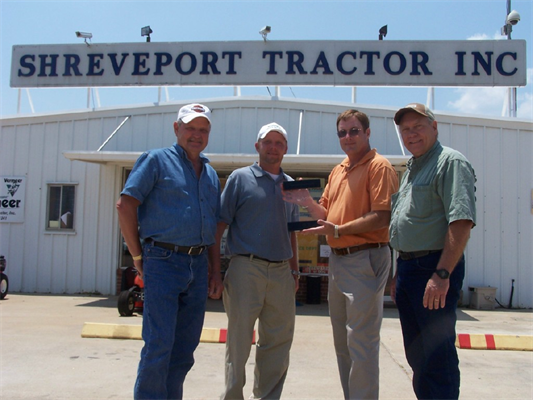 Award presented to Fred Forsythe-Owner, Keith Forsythe-General Manager, (David Little-Kubota Regiona